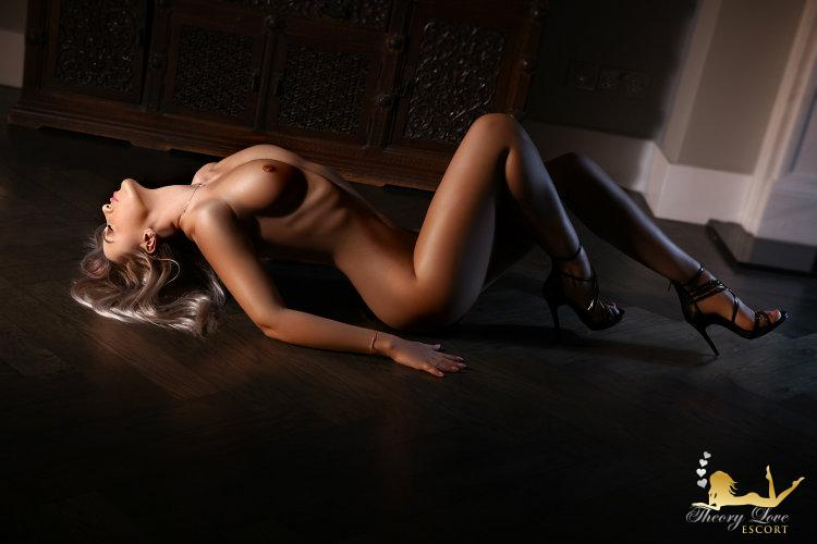 Bisexual girl lies on a floor naked