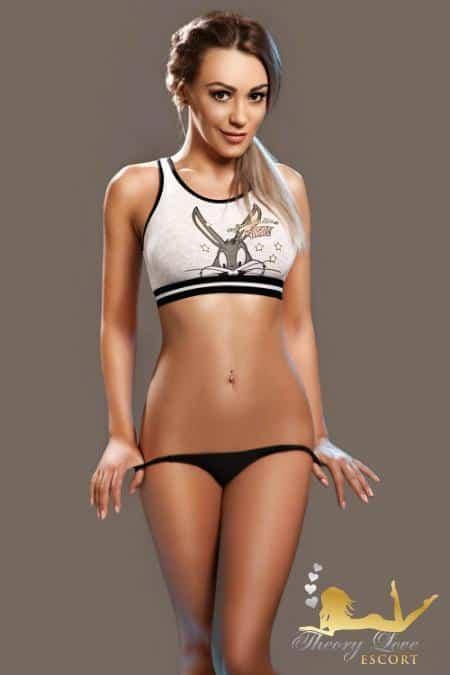 Denisse cute London escort in a white top with a black panties