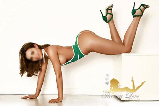 Spanish escort in a plank position doing photoshooting.