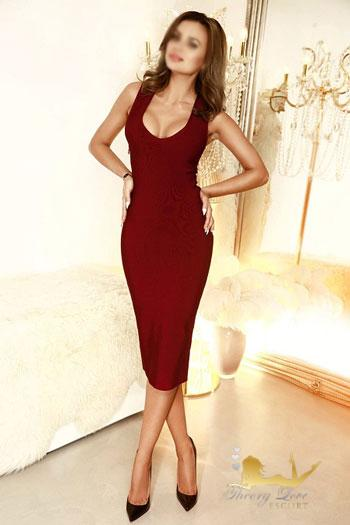 Spanish escort in London posing dressed in a amazing red dress.