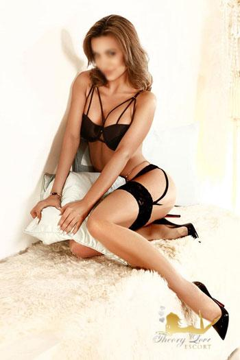 Hot Female escort posing in a black underwear.