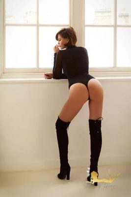 Sexy photo in high heel boots